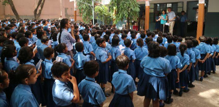 Karyne and Dycke speaking to hundreds of children