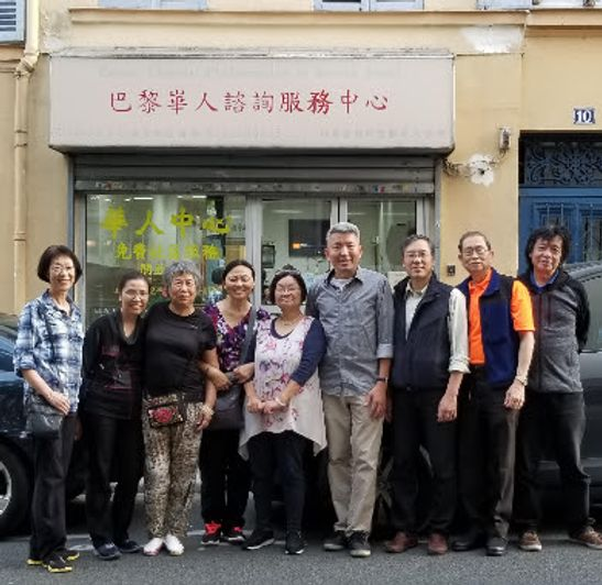 Dycke and other people posing in front of a chinese church