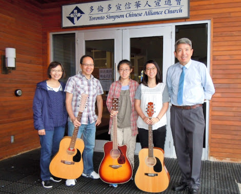 Noelle and Pascale with their guitar teacher and their guitars